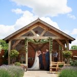 Bride & Groom share 1st kiss in the Arbour at Upton Barn