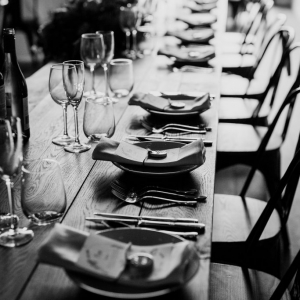Close up of place settings in a line on the top table